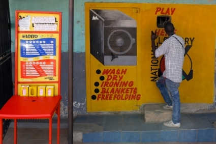 Lottery station with hand-painted advertising adorning the shop in Alexandra Township, Johannesburg.