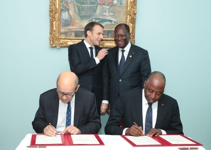 Macron and Ouattara attended the signing of an AFD aid package.