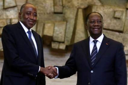 Amadou Gon Coulibaly (left), Alassane Ouattara's (right) heir apparent in 2020's presidential run.