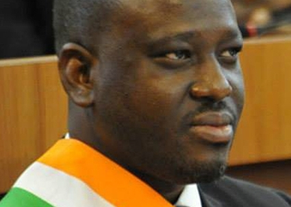 Guillaume Soro, from battle dress to business suit