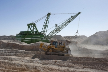 A dragline carries untreated phosphate after being dropped off on a mountain at a phosphate mine at the Boucraa factory of the National Moroccan phosphate company (OCP) situated in the southern provinces.