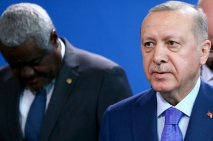 Turkish President Recep Tayyip Erdogan (foreground) and African Union Commission Chairperson Moussa Faki Mahamat (background).