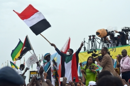 People celebrate after the signing of the Juba agreement on October 3, 2020.