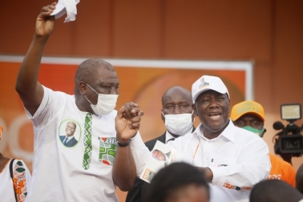 Ivorian President Alassane Ouattara (R) and his Prime Minister Hamed Bakayoko (L) during the 2020 presidential campaign.
