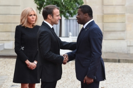 Togolese President Faure Gnassingbé at the Elysee Palace in 2019 with his counterpart Emmanuel Macron and his wife Brigitte Macron.