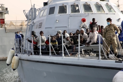 Migrants are seen on the deck of a Libyan Coast Guard's ship in Tripoli, Libya, on 29 April 29 2021.