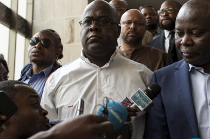 Congolese President Félix Tshisekedi (center) and his former fallen chief of staff Vital Kamerhe (right).