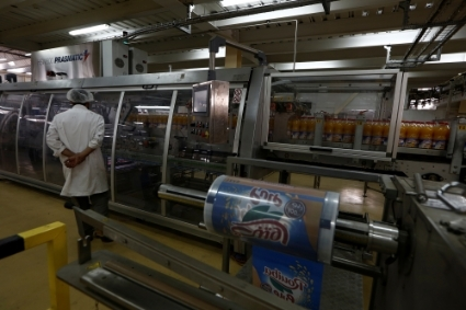 An employee monitors production at the Rouiba drinks factory on the outskirts of Algiers.