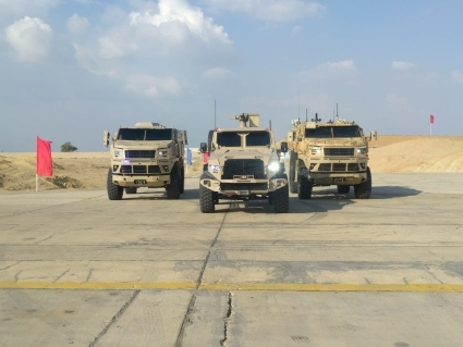 The armoured vehicles IMUT ST-500 (centre) and ST-100 (left and right).
