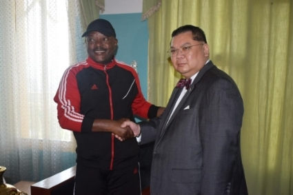 US Special Envoy J. Peter Pham, mender-in-chief of fences between Bujumbura and Washington, with Burundi's late president, Pierre Nkurunziza.