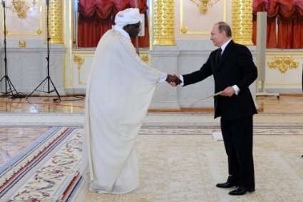 Vladimir Putin receives credentials from Sudan ambassador to Russia, Nadir Babiker, in 2015.