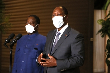 Alassane Ouattara (right) and Henri Konan Bédiémet on 11 November 2020.