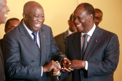 Laurent Gbagbo and Alassane Ouattara during a meeting in Abidjan November 27, 2010.