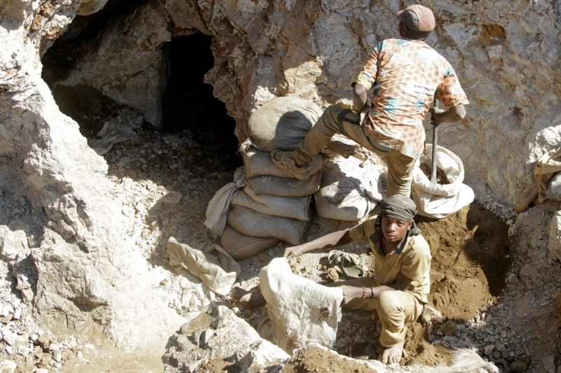 Artisanal miners work at the Tilwizembe outside of Kolwezi.