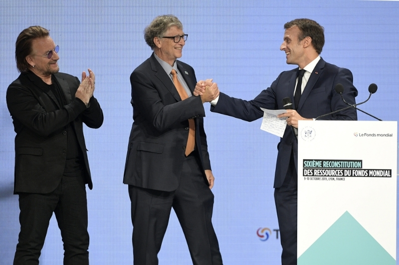 French president Emmanuel Macron, with Bono and Bill Gates, announces the amount raised at the 6th Global Fund to Fight AIDS, Tuberculosis and Malaria replenishment conference in Lyon on 10 October 2019.