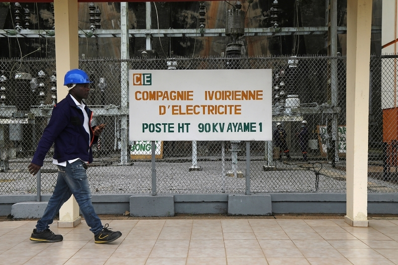 An employee of the Ivory Coast Electricity Company (CIE) at a hydroelectric dam station.