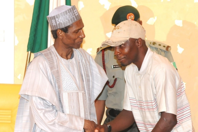 Tompolo, then MEND leader, in 2009, with Nigerian President Umaru Yar'adua, accepting amnesty.
