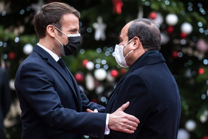 French president Emmanuel Macron and Egyptian president Abdel Fattah Al-Sisi upon his arrival for a meeting at the Elysee Palace in Paris on 7 December.